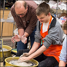 Young Adult making clay pot